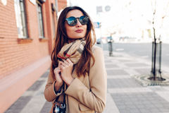 Beautiful and young girl in a coat and scarf Royalty Free Stock Photo