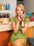 Beautiful young girl with a coffee mug Royalty Free Stock Photo