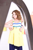 Beautiful young girl in colorful dressing room Royalty Free Stock Photos