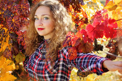 Beautiful young girl in colorful grape vineyard Royalty Free Stock Photography