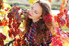 Beautiful young girl in colorful grape vineyard Royalty Free Stock Photo