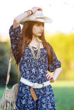 Beautiful young girl in a cowboy hat. Royalty Free Stock Image