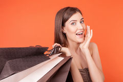 Beautiful young girl is crazy about shopping Stock Photos