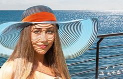 Beautiful young girl on cruise in sea Royalty Free Stock Image