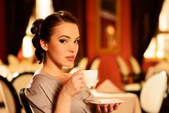 Beautiful young girl with cup of coffee Stock Images