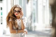 Beautiful young girl with curly hair Stock Image