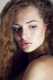 Beautiful young girl with curly hair Royalty Free Stock Image