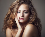 Beautiful young girl with curly hair Stock Images
