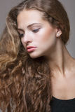 Beautiful young girl with curly hair Royalty Free Stock Photography