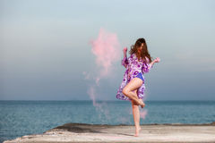 Beautiful young girl dancing with colors Royalty Free Stock Images