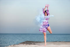 Beautiful young girl dancing with colors Stock Photo