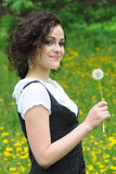 Beautiful young girl with dandelion Stock Photography