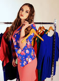 Beautiful young girl with dark curly hair in wardrobe room Stock Photography