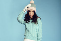 Beautiful young girl with dark curly hair wears cozy warm clothes Royalty Free Stock Photo