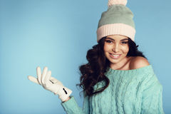 Beautiful young girl with dark curly hair wears cozy warm clothes Stock Photos