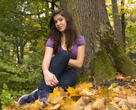 Beautiful young girl with dark hair in the park 4 Royalty Free Stock Photography