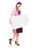 Beautiful young girl with dirndl dress holding white board Royalty Free Stock Photos