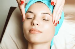 Anti aging facial massage stock photography
