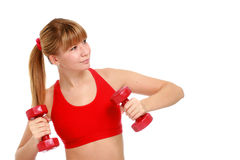 Beautiful young girl doing fitness exercises. Royalty Free Stock Images
