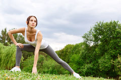 Beautiful young girl doing gymnastic in park Stock Photo