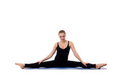 Beautiful young girl doing gymnastic splits on mat Stock Photography