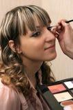 Beautiful young girl doing makeup Royalty Free Stock Images