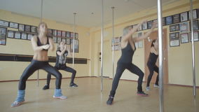 Beautiful young girl doing workout in dance studio stock footage video stock footage