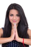 Beautiful young girl doing yoga salutation Stock Photo