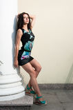 Beautiful young girl in dress over urban Royalty Free Stock Photos