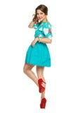 A beautiful young girl in a dress posing Stock Photo