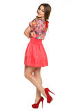 A beautiful young girl in a dress posing Stock Photos