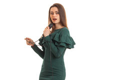 Beautiful young girl in a dress singing into a microphone Royalty Free Stock Photo