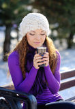 Beautiful young girl drinking coffee Stock Photography