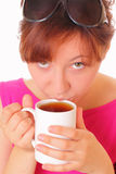 Beautiful young girl drinking a cup of tea Royalty Free Stock Photography