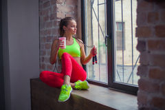 Beautiful young girl is drinking a fitness smoothie. Healthy lifestyles concept. Stock Image