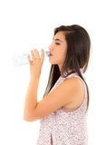 Beautiful young girl drinking water from a plastic Royalty Free Stock Images