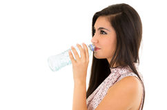 Beautiful young girl drinking water from a plastic Stock Photo