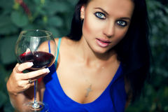 Beautiful young girl drinkink wine Royalty Free Stock Images