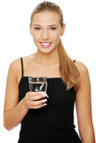 Beautiful young girl drinks water Royalty Free Stock Image
