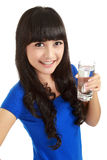 Beautiful young girl drinks water from glass Stock Image