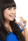 Beautiful young girl drinks water from glass Royalty Free Stock Photo