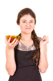 Beautiful young girl eating fresh tomatoes Stock Photos