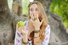Beautiful young girl eating green apple Royalty Free Stock Photo