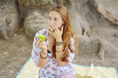 Beautiful young girl eating green apple Royalty Free Stock Photos