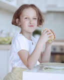Beautiful Young Girl eating sandwich Stock Photography