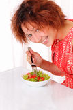Beautiful young girl eating tasty salad Stock Photos