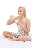 Beautiful young girl eating yogurt Royalty Free Stock Images