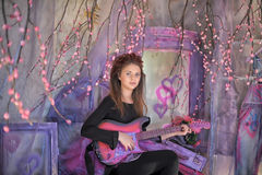 Beautiful young girl  with electric guitar. Stock Image