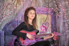 Beautiful young girl  with electric guitar. Royalty Free Stock Images