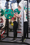 Beautiful young girl engaged fitness in the gym. Royalty Free Stock Photography